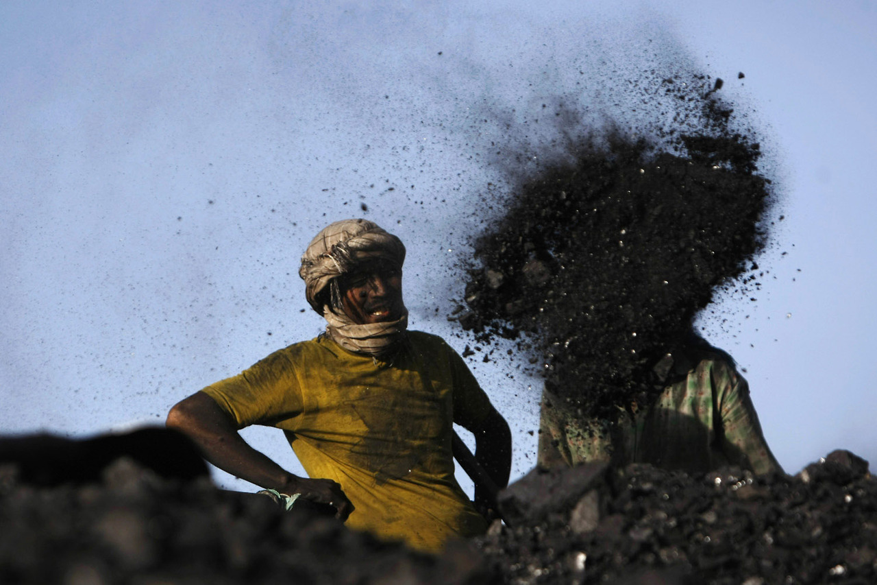 Labourers work at a coal dump site outside Kabul